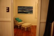 Master Bedroom artwork and I LOVE this chair and ottoman